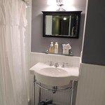 Garden Room: bathroom vanity and mirror with great lighting