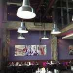 Industrial theme restaurant including lighting and a huge overhead crane