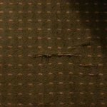 Worn carpet behind the desk chair
