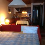 Room with double bed.  3 Single bed room to side