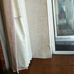Curtain and wall paper damage