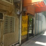 "The entrance is down the small alley next to the tailor shop which i think is also owned by ""Sam"