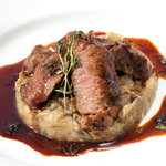 one of our guest's favourite, Lightly cooked lamb loin served on a bed of grilled aubergine