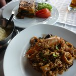 Moussaka in the background and massive portion of seafood risotto in front (very spicy!)