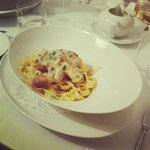 Fish on a bed of tagliatelle with lemon sauce