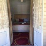 French doors open onto lovely verandas