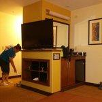 TV, small fridge and coffee area