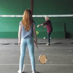Nana learning how to play badminton with her niece