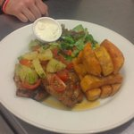 Jerk pork steaks, pineapple salsa and sweet potato chips