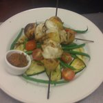 Monkfish skewers, chargrilled courgette salad and homemade tomato tapenade
