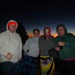 Trying to keep warm in 54 degree weather at Haleakala Sunrise