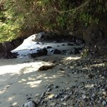 rock arch - tide was low so we were able to walk to a second waterfall.   waiter was so clear!
