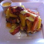 Vanilla waffles with mango, caramelised apples & custard