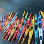 Kayaks by the dock under the 7th Wave restaurant