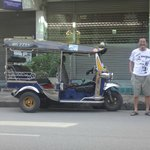 Guesthouse owner with tuktuk