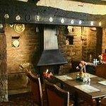 Cozy lounge bar with inglenook fireplace