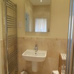 Heated towel rail and mirror with built-in lights in room 1