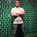 posing with beer bottle background