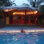 Pool and outdoor bar at the evening