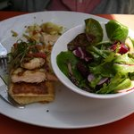 Grilled chicken breast crepe with green salad.
