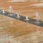 Fountains at the entrance to Liverpool 1 illustrate the heights of tides