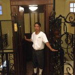 Incredible historic caged elevator with attendant