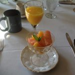 First course of breakfast, generally fresh fruit, or fresh fruit with granola, yogurt etc
