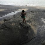 The dirty black sands beack in Langkawi