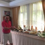 The hotel owner, proudly showing off the breakfast buffet