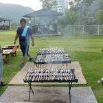 The hotel staff barbecuing fish they bred