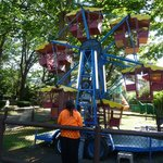The kiddie ferris wheel, there is a larger ferris wheel that adults can ride on.