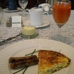 "Summer vegetable frittata with sausages and Donnie's famous ""combo"" of cranberry and orange juic"