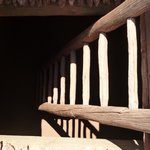 The ladder descends down about 12 feet to the floor of  a restored kiva