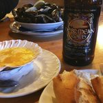 Beer, fresh bread and garlic butter and mussels.