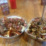Meat lovers on left ( medium) Ian on the right ( small) (( smoked meat, onion, bacon, bacon))