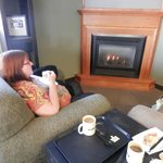 Enjoying the armchairs, fireplace and coffee at Bixby's!