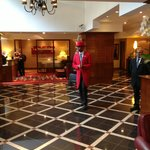 Lobby with doorman in traditional red coat
