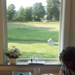 view of the orchards and the river from breakfast room