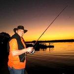 Fishing at Dusk Along the Riverbank