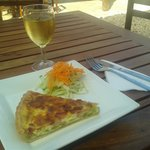 Quiche, mixed greens and a glass of French white wine