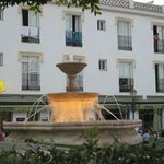 Hotel is in a small square with other cafes etc with tables outside(in eveing the fountain is li