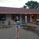 my daughter infront of the motel