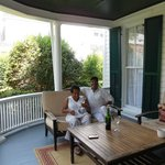 Guests Pat and Brad relax on wrap around front porch