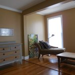 Sitting aea of spacious, suny bedroom with attached bathroom