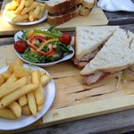 Sandwich, chips and salad on a board