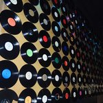 a wall of old vinyl records