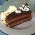 The lovely chocolate cake with ice cream