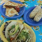 Chorizo quesadilla, Mexican corn on the cob, taco plate (pescado and al pastor)