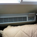 A/C unit next to bed