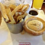 Chicken and mushroom pie, there was a pot of mushy peas behind the chips too.